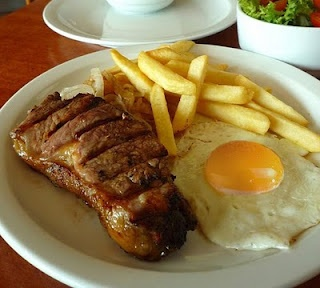 typical chilean dish: Lomo a lo pobre....yummm! best steak ever!