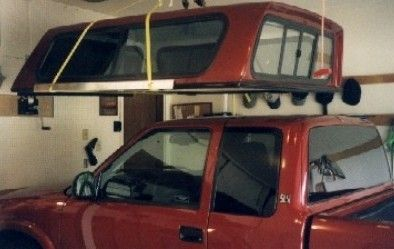 Caplift, one person pickup cap removal and storage system.
