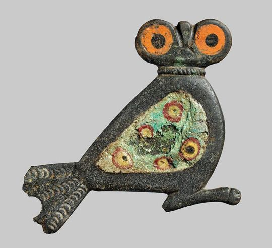 "Iron Age Owl Brooch Unearthed in Denmark  Shaped like an owl, the brooch, which has large orange eyes and colorful wings, dates to the Iron Age, and would have been used to fasten a man's cloak. ""There are very few of these types of fasteners,"" archaeologist Christina Seehusen of Bornholm Museum told The Copenhagen Post. It was probably made along the Roman frontier, in Cologne or another nearby town."