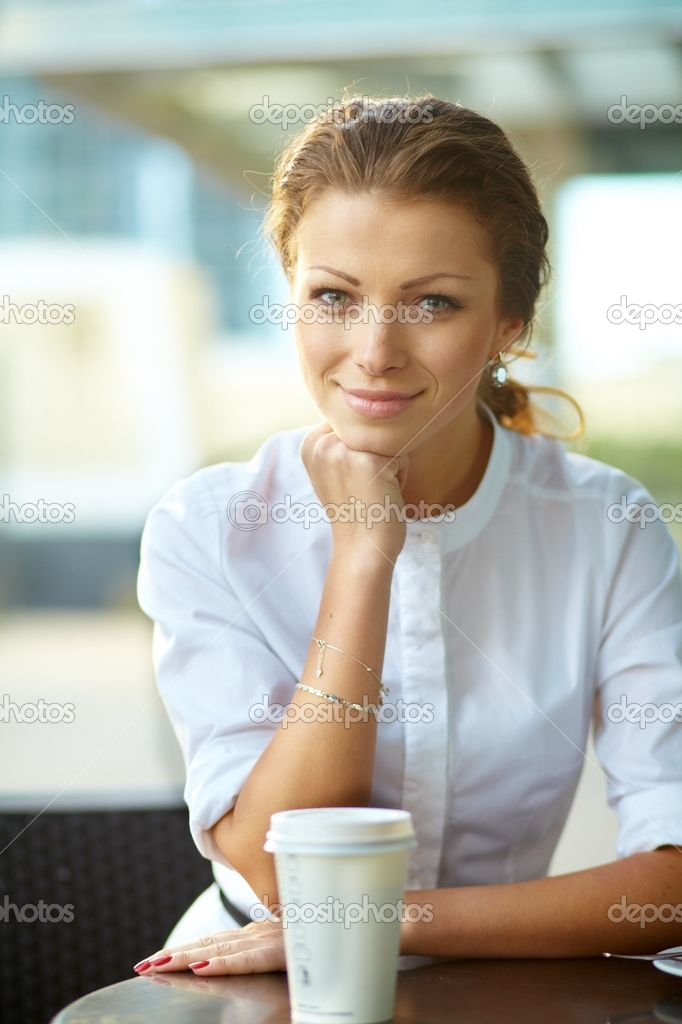 Portrait of young smiling business woman resting her chin on han   Stock Photo © Andrei Zarubaika #12478733