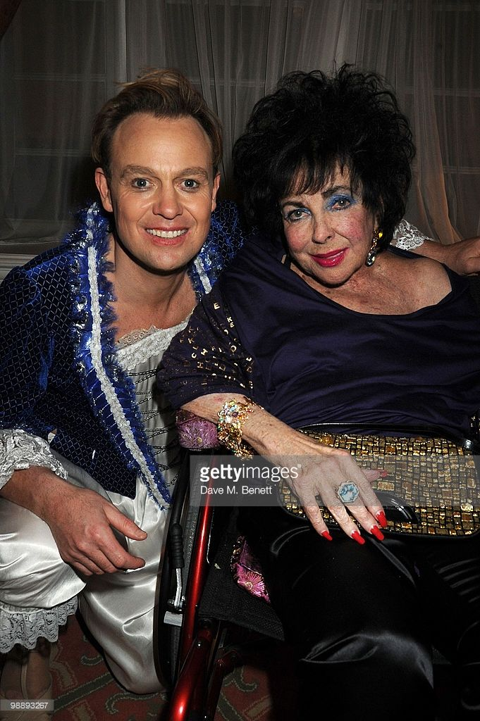 Dame Elizabeth Taylor poses backstage with Jason Donovan following the performance of 'Priscilla Queen Of The Desert', at the Palace Theatre on May 6, 2010 in London, England.