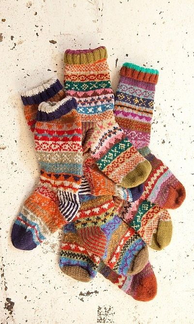 You can't beat hand knitted socks - they make a great christmas present and the perfect thing to keep cosy in around the fire. House - Plümo Ltd