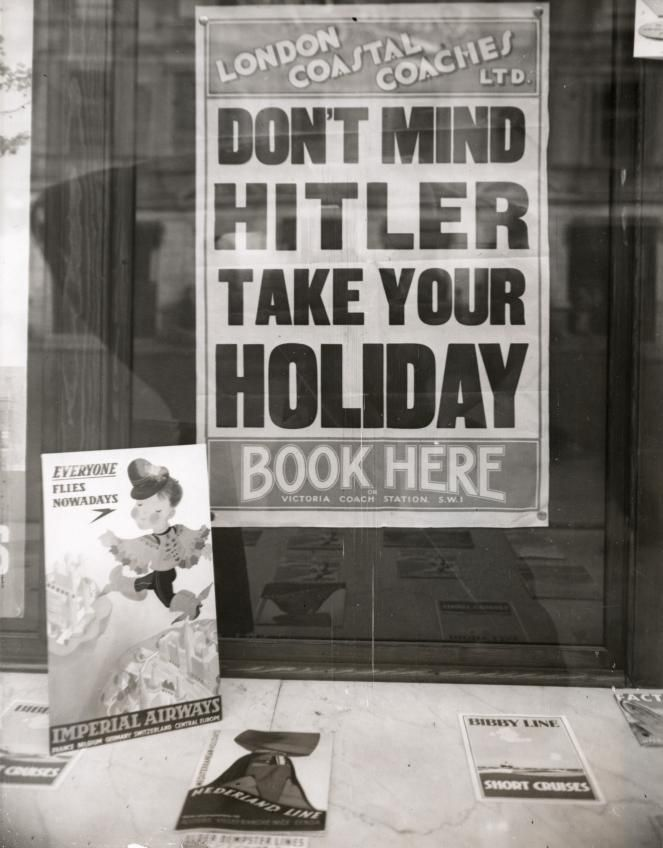 1939 - Don't mind Hitler: Take your holiday. Book here. London Travel Agency...don't forget, at this time the atrocities were not yet known to the general public. The British, Londoners in particular, were hit by the Germans 54 consecutive nights during the blitz. They were battered yet remained stoic and unmoving in their bid for survival.