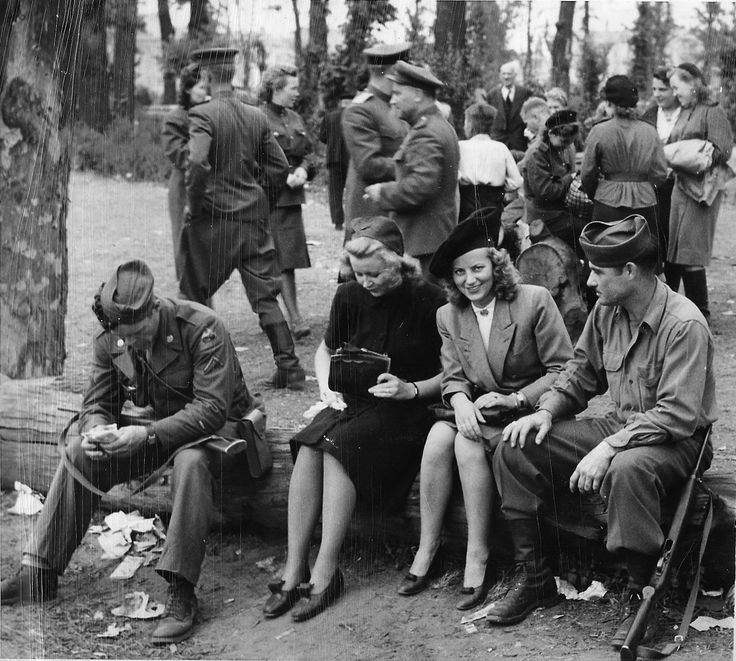 "American GIs talk with young German ladies in Berlin's Tiergarden in August 1945. A group of Soviet soldiers is in the background. ""Fraternization"" was officially discouraged and sometimes punished. That of course couldn't stop ""friendly chatting."" In the two years following the end of the war GI applications for marrying German women increased manifold."