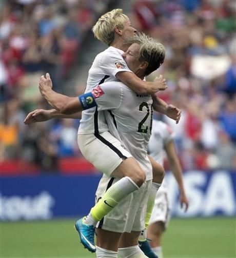 United States' Abby Wambach celebrates her goal with teammate Megan Rapinoe during the first half of a FIFA Women's World Cup soccer match, Tuesday, June 16, 2015 in Vancouver, New Brunswick, Canada (Jonathan Hayward/The Canadian Press via AP) MANDATORY CREDIT ▼17Jun2015AP|Wambach's goal gives US a 1-0 win over Nigeria http://bigstory.ap.org/article/a1caab33797d49af94f2548399fa3065 #2015_FIFA_Womens_World_Cup #Group_D_Nigeria_vs_United_States