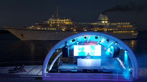 The Shimmy stage with a beautiful cruise liner sailing by. Shimmy Beach Club, Dec 2015.  Restaurant,Club and private beach. Cape Town's favourite hot spot.