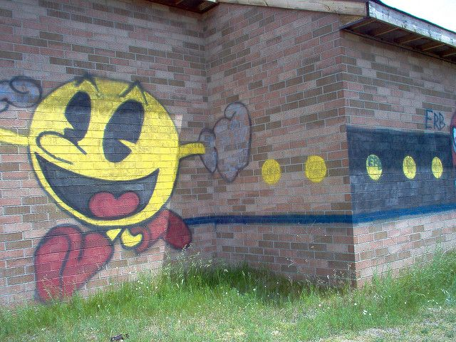"""Pac-Man graffiti on the wall of an abandoned prison, location unknown. Photo by """"Juliet_MC"""", June 10, 2007"""