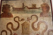 L'affresco con il Navigium Isidis, rinvenuto nel Sacrarium del Tempio di Iside a Pompei, è esposto nel Museo Archeologico Nazionale di Napoli (inv. 8929) (cat. 1.74). Fra due busti di divinità fluviali vi sono due imbarcazioni di giunchi, sulla sinistra delle quali vi è Iside che traina con una fune la barca di destra sulla quale vi è una cassa quadrata con un falco dipinto sopra. Al di sotto vi sono due grandi serpenti affrontati ai lati di una cesta di vimini con coperchio conico.