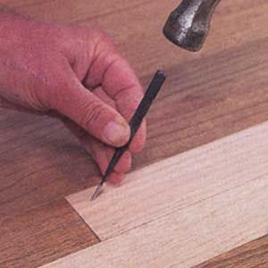 How to repair and replace boards in a hardwood floor.