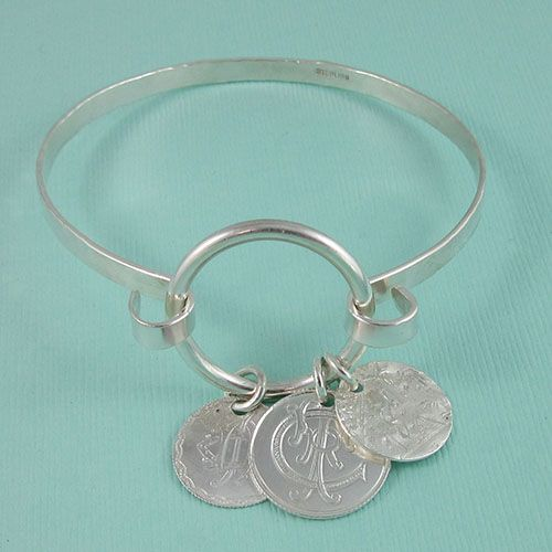 Sterling Silver Bracelet with Antique Love Tokens $160.00