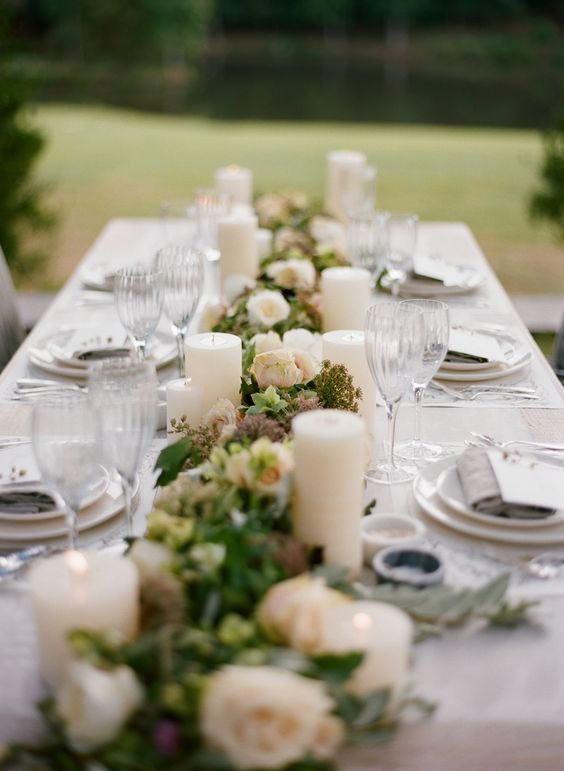 Romantic Outdoor White Candle Wedding Reception Centerpiece; Featured  Photographer: Eric Kelley, Via Mallory