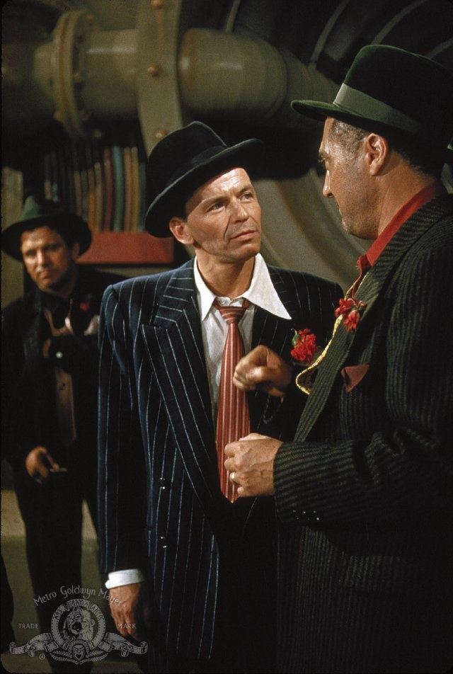 Guys and Dolls (1955)  Marlon Brando, Jean Simmons, Frank Sinatra  - Director: Joseph L. Mankiewicz  IMDB: In New York, a gambler is challenged to take a cold female missionary to Havana, but they fall for each other, and the bet has a hidden motive to finance a crap game.