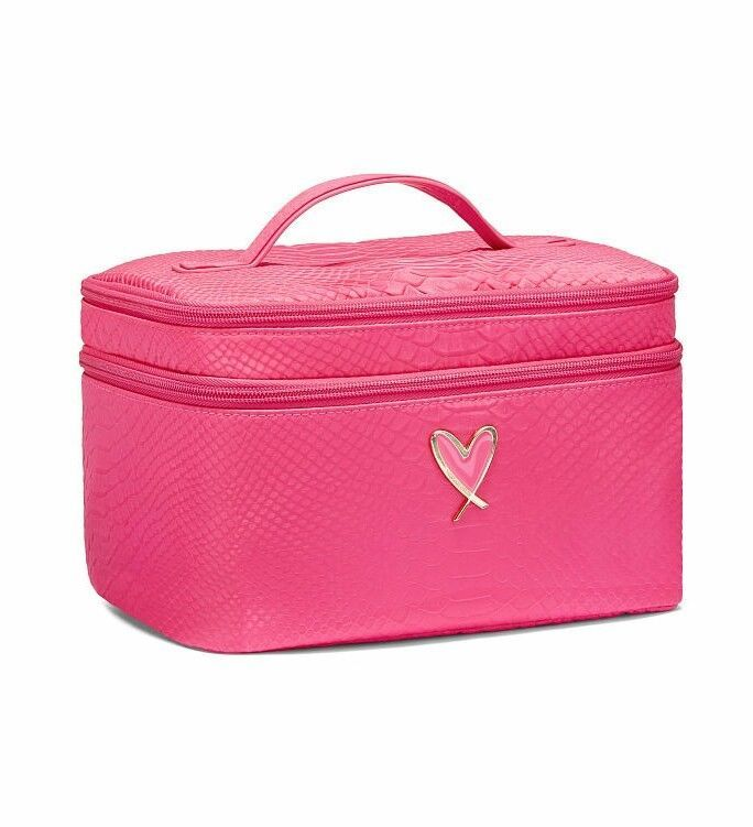 "Victoria's Secret train case bag Product Details Favorite style updated with a cute heart logo! Perfect for makeup, brushes, jewelry and other beauty essentials Top compartment with mesh zip pocket and brush organization Train case: 9¼""L x 6¼""W x 6""H 