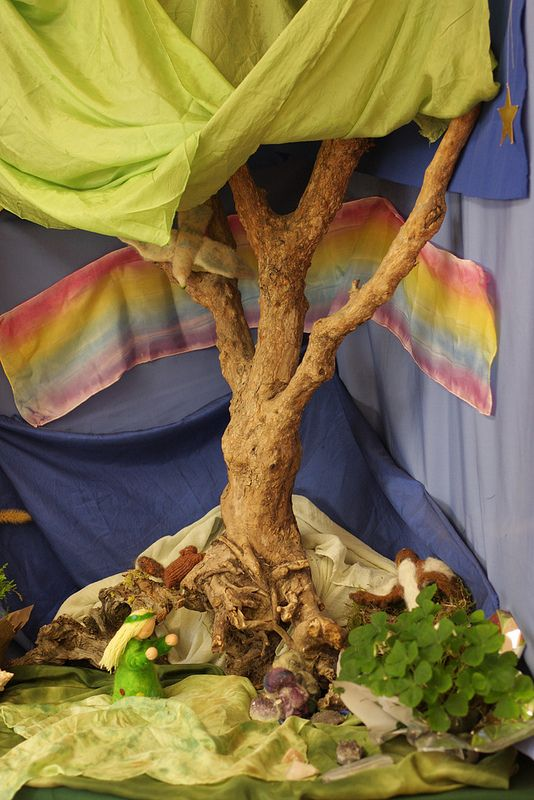 Summery nature table. I love the use of fabric for tree leaves.