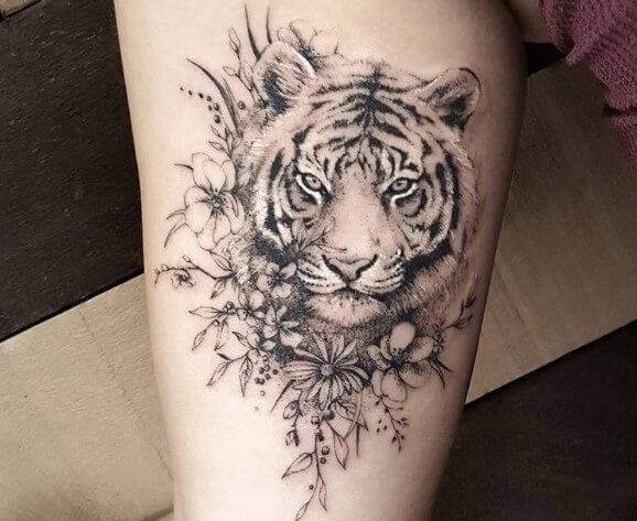 12 Best Tiger And Flower Tattoo Designs In 2020 Tattoos Animal Tattoos Tiger Tattoo Thigh