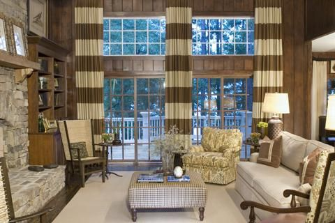 media rooms - striped floor to ceiling window treatments ivory paisley print ottoman rocker stone fireplace Horizontal striped ivory and taupe