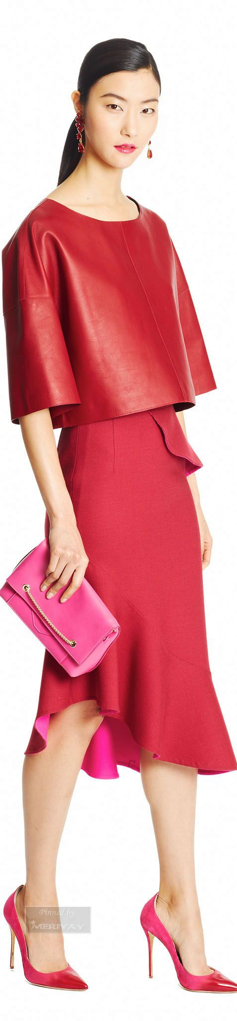 Oscar de la Renta.Pre-Fall 2015. Red leather top with matching Red skirt and a pink clutch, perfectly matching contrast