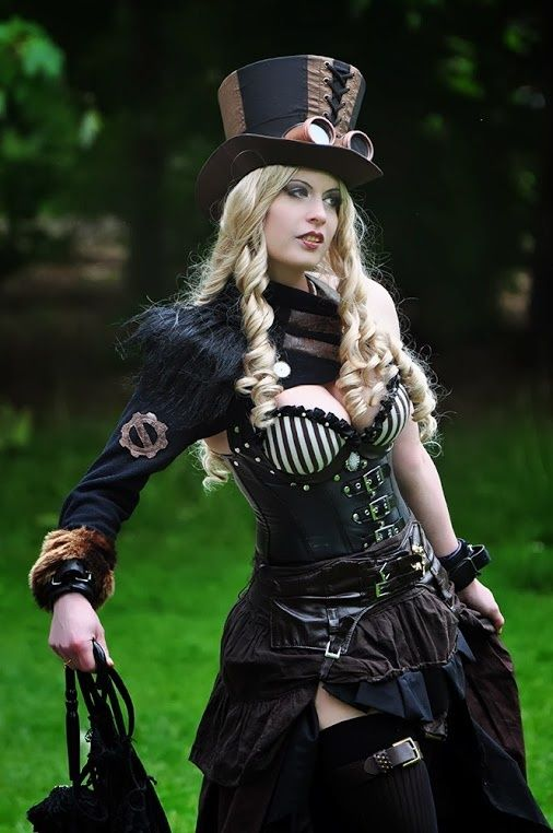 Diesel Steampunk Gypsy with classic top hat & bodice featuring bold black & white stripes. Bolero style jacket has only one sleeve.