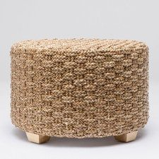 The Valerie is a low, round, woven ottoman or accent table. The seagrass highlights the structured weaving and creates a clean feel. Set off the ground with small hidden feet.