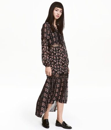 Black/roses. Maxi dress in airy, crêped chiffon with a printed pattern. Lace trim inserts, V-neck with lacing at front, and long sleeves with elasticized