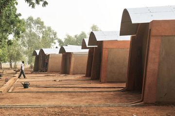 Diébédo Francis Kéré's works on the premise that building with mud and clay is not only inexpensive and sustainable; it also constitutes a unique cultural asset. Özlem Özdemir spoke to the architect from Burkina Faso about why mud's appeal as a building material, knowledge transfer in his homeland and the responsibility to preserve one's own culture.