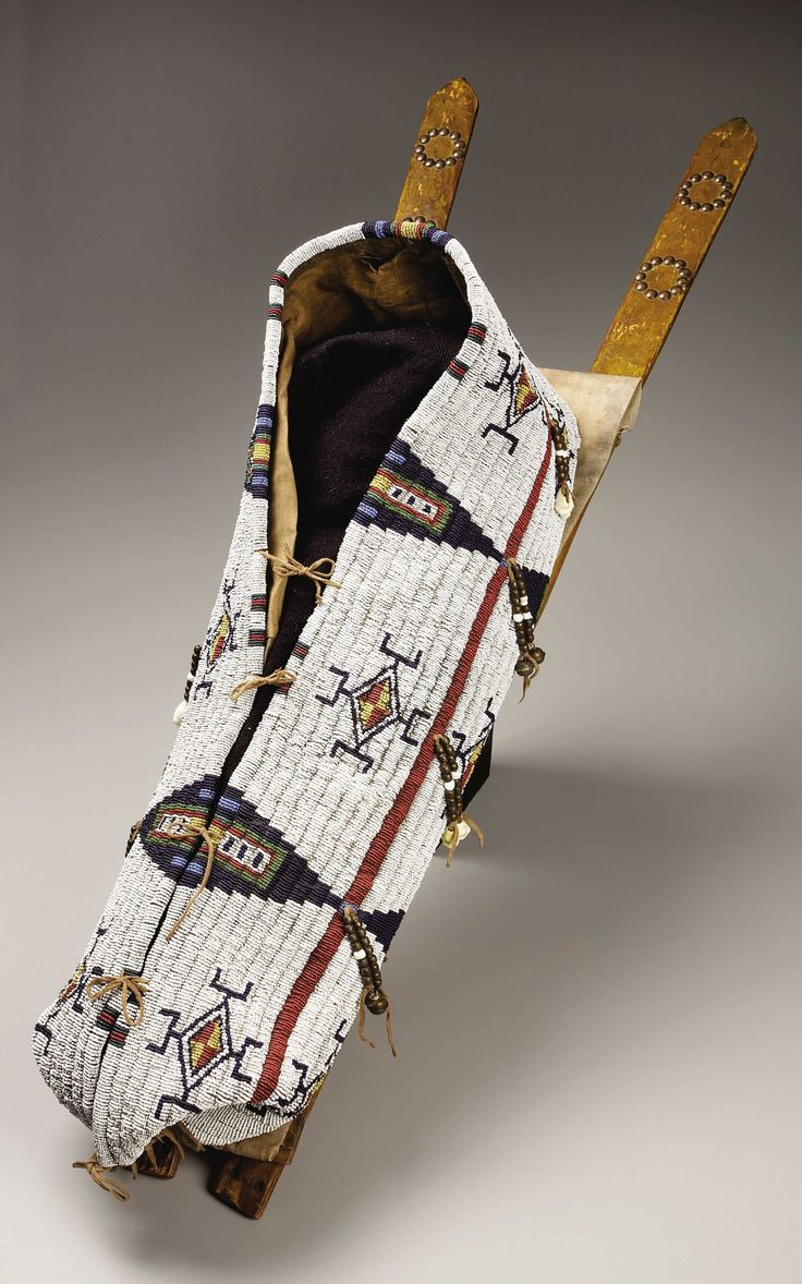 A NORTHERN CHEYENNE BEADED HIDE BABY CARRIER. c. 1880. ... American   Lot #77089   Heritage Auctions