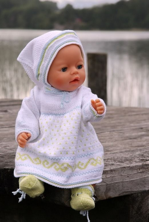http://www.doll-knitting-patterns.com/images/0060D-knitted-doll-clothes-0.jpg
