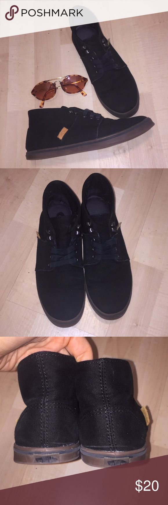 Vans Mid-rise Sneakers All black canvas vans. Not quite low or high.. sort of mid-rise. Leather Vans tags and gum colored soles. Inside sole needs a little shoe goo, or could go without.. doesn't look separated unless you pull it. Size 7. Vans Shoes Sneakers