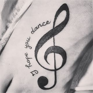 Does your treble clef tattoo remind you to dance on? | Show Us Your Music-Inspired Tattoo