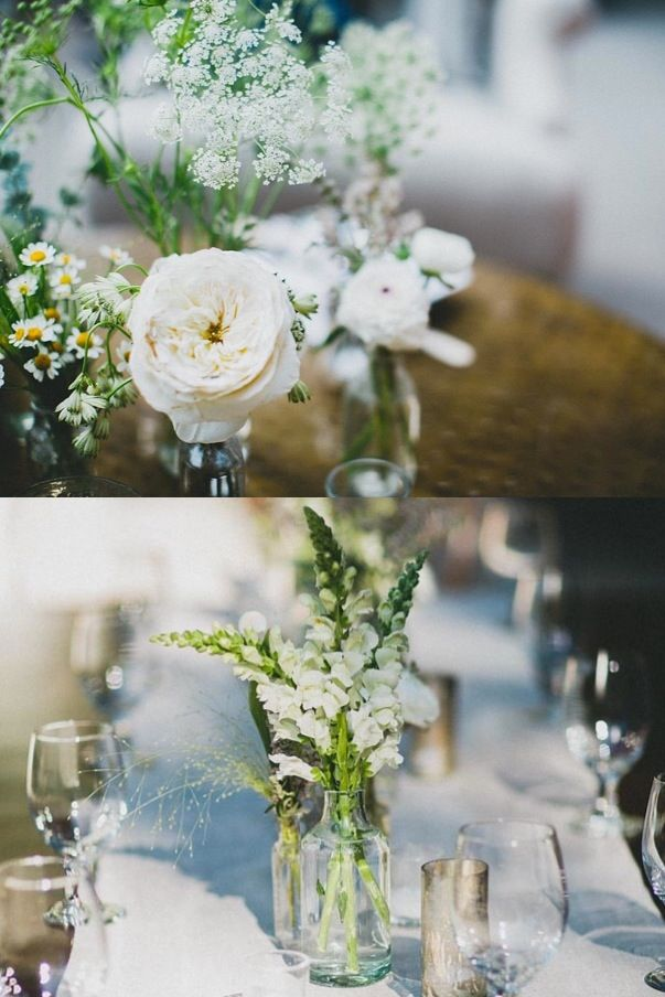 "Kept with the neutrals theme here. I wanted a natural look, not too arranged. We used assorted wild flowers in cream, white and sage in mismatched votives.   Florals done by Twig and Twine. Watch more of my wedding happenings in the ""My Dear"" video - http://bit.ly/KinaMyDear"
