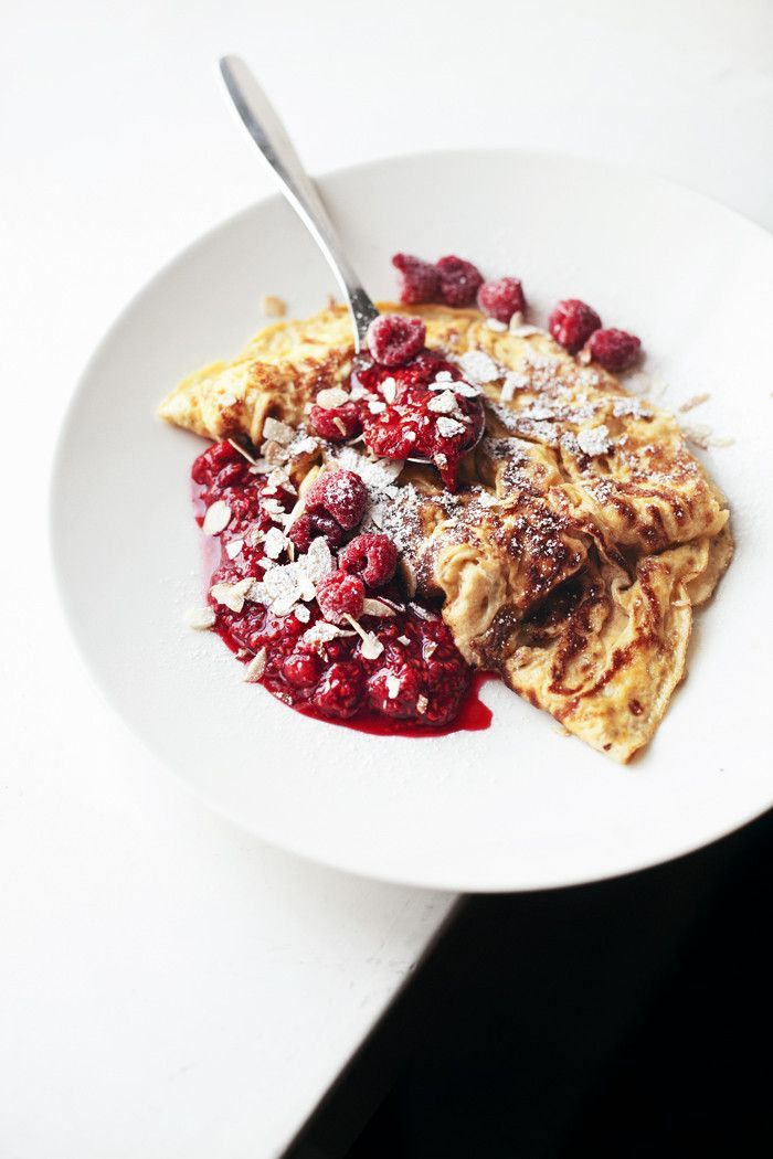 Omelette with raspberries and toasted almond flakes.