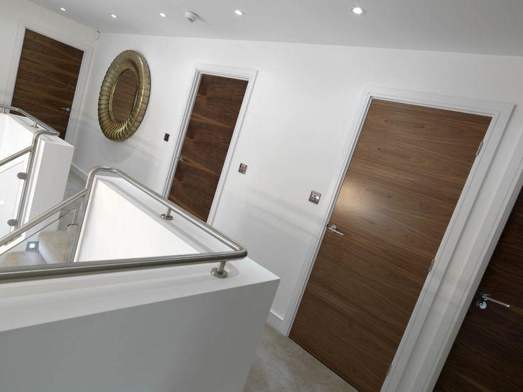 Walnut internal doors look stunning in a sequence. JB Kind's Walnut Flush - Fernor