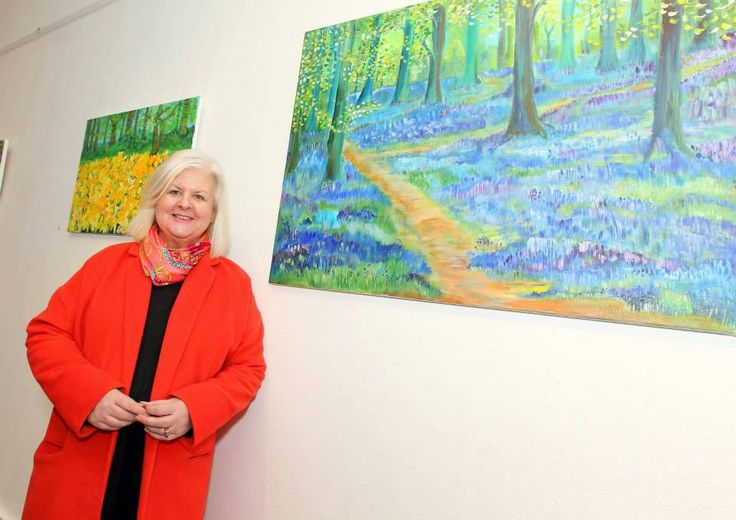 Mailo Power pictured beside one of her colorful paintings inspired by Mount Congreve www.noelbrownephotographer.com