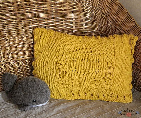 A knitted decorative pillowcase for pillows. At the center of the pillow a cute motif of a cottage and the surrounding garden was created. Thanks to its warm yellow color and wood buttons it has a natural but lively look. Its a fluffy, warm decoration and it can give a special touch to any sofa, armchair or bed. Perfect in a child's bedroom where it can become a furniture to hug. Its a fantastic gift idea.  • SIZE | 49x35cm / 19,2x13,7 inch • FABRIC | 100% wool • COLOR | yellow • 100% ha...