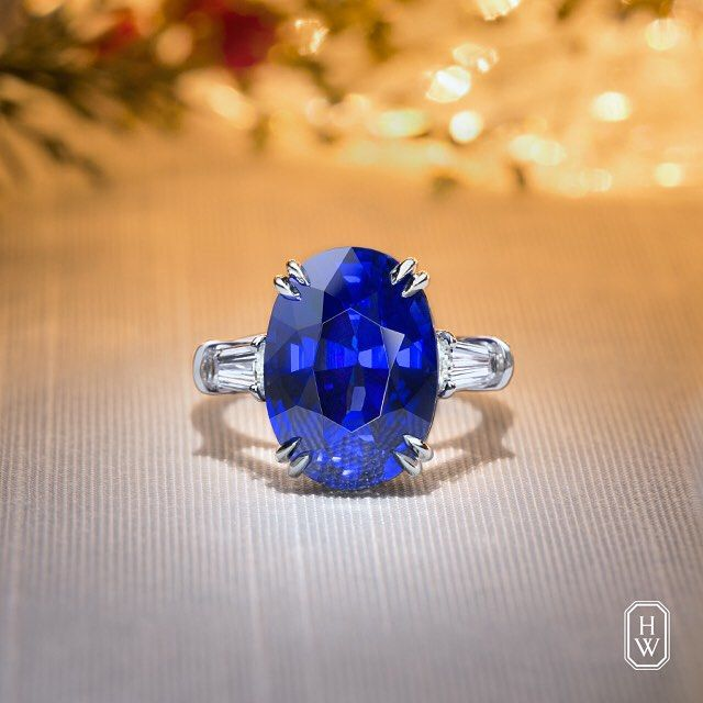 Harry Winston 12.71 carat Oval-Cut Sapphire Ring with Diamond Tapered Baguettes.