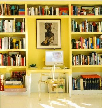 yellow bookshelves and a desk from Domino.