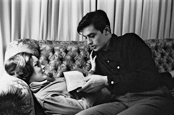 Alain Delon reading to Romy Schneider.