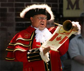 BEEN - Kingston, Ontario, Canada.  Town has a strong British Heritage (hence the Town Crier).  Kingston was once a Capital City of Canada (before Confederation).  And the city is uniquely located at the Mouth of Lake Ontario.  Also has War of 1812 History.