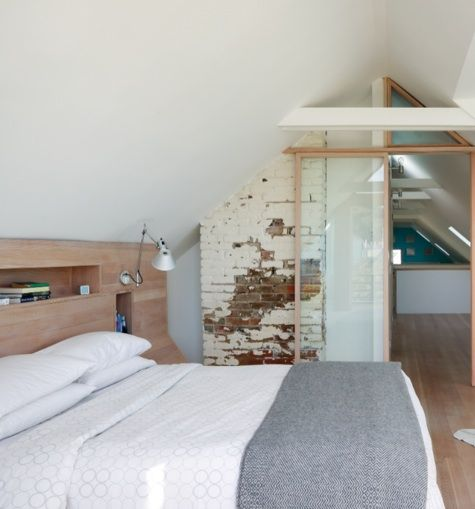 Fantastic loft conversion - bedroom. Love the exposed bricks and built-in headboard.