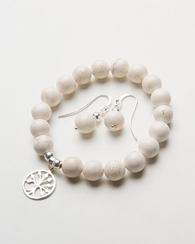 HOWLITE CHARM BRACELET $38.00  This beautiful bracelet is handcrafted with stunning howlite stone and finished with a sterling silver beads on a high quality stretch transparent elastic. Howlite is a beautiful stone featuring erratic streaks that appear like cracks throughout the stone often in browns, greys or blacks.