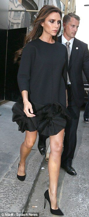 Showing some leg: Victoria was wearing an unusual mini dress with peplum hemline and heels for her site visit
