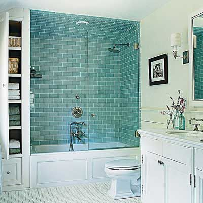 Vintage Vibe    The master bathroom's basketweave tile floor, pale blue subway-tiled shower, and paneled tub create a vintage look in the newly built 7-by-14-foot room. Reclaimed poplar for the wainscoting adds to the character and appearance of age.