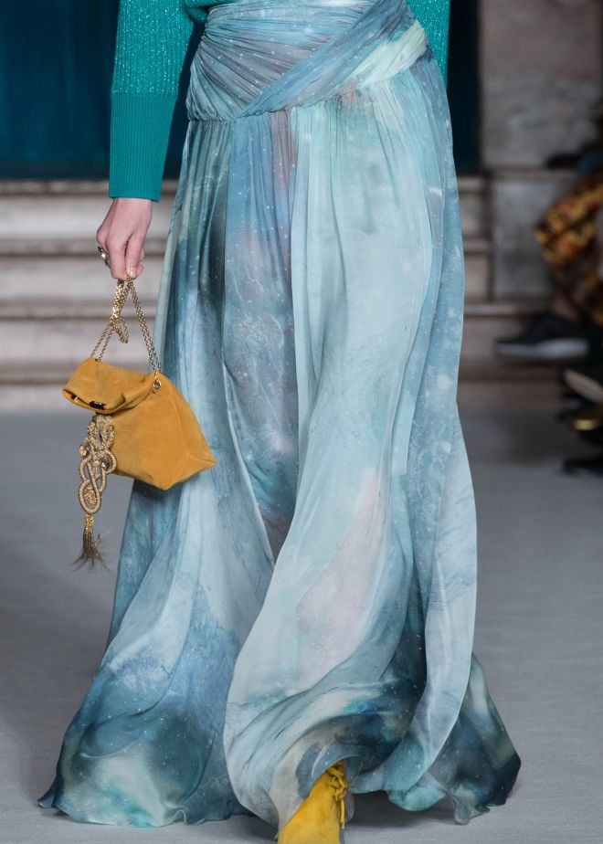 Stars glitter in the darker skies as galaxies swirl far away- the Matthew Williamson AW15 aquamarine patina galaxy maxi skirt as seen on the catwalk during London Fashion Week. Click to see it up close.
