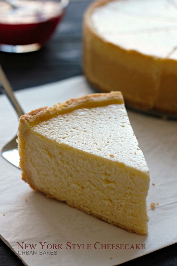 Classic New York Style Cheesecake.CRUST 2 cups all-purpose flour 1 cup butter, softened 1/2 cup granulated sugar 2 egg yolks CHEESECAKE 5 (8 oz.) packages *Neufchâtel cheese, softened 1 3/4 cups granulated sugar 3 tablespoons all-purpose flour 1/4 teaspoon salt 5 whole eggs 2 egg yolks 1/4 cup whipping cream