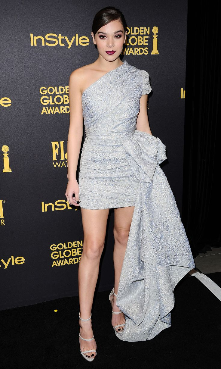 HAILEE STEINFELD wears a gray one-shouldered Reem Acra brocade mini dress with a dramatic peplum flourish elegantly draped to the side, and matching strappy Giuseppe Zanotti Design sandals at the Hollywood Foreign Press Association and Instyle's Celebration of the 2017 Golden Globe Awards in Los Angeles.
