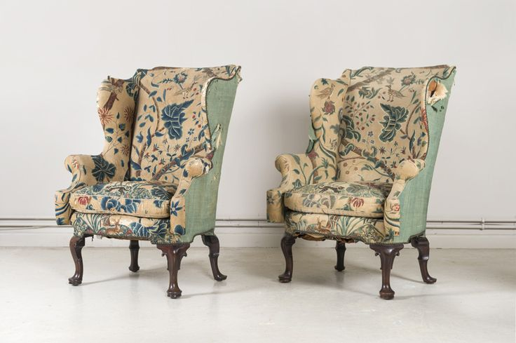 A pair of wing chairs, one George II, covered in its original crewel-work, c 1735, the other a late nineteenth century copy, covered in crewel-work of the same period  SOLD