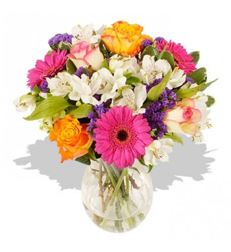 This charming small bouquet will send a breath of fresh colourful air during these dark dismal post-Christmas  days.  The clear bright colours and the lovely selection of different flowers, each with their own particular style, combine to make a wonderful bouquet to send during the cold days of early spring with a real promise of the sunny days to come.