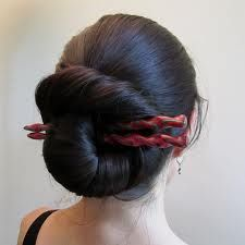 Long hair styles: big nautilus bun with twisty sticks