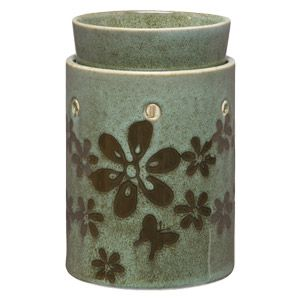 Welcome spring as hand-painted pewter flowers and a dainty butterfly flutter across a seafoam background. To purchase, go to www.jenni.scentsy.com.au