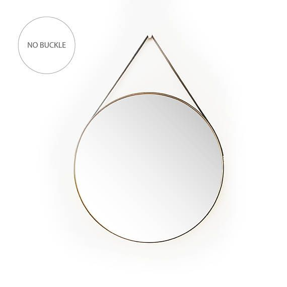 Beautiful Leather Strapped Mirror Have you always wanted the look of an Adnet Mirror but couldnt afford the price? Get the look for a fraction of the price! I have designed this beautiful leather kit that wraps snugly around this mirror. Made from genuine quality English leather and